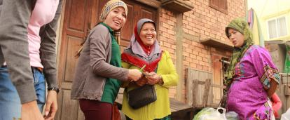 High School Special volunteer collects a loan repayment from a beneficiary in Cambodia.
